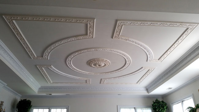 This Ceiling Design Frames A Rosette At Its Center In Private Residence